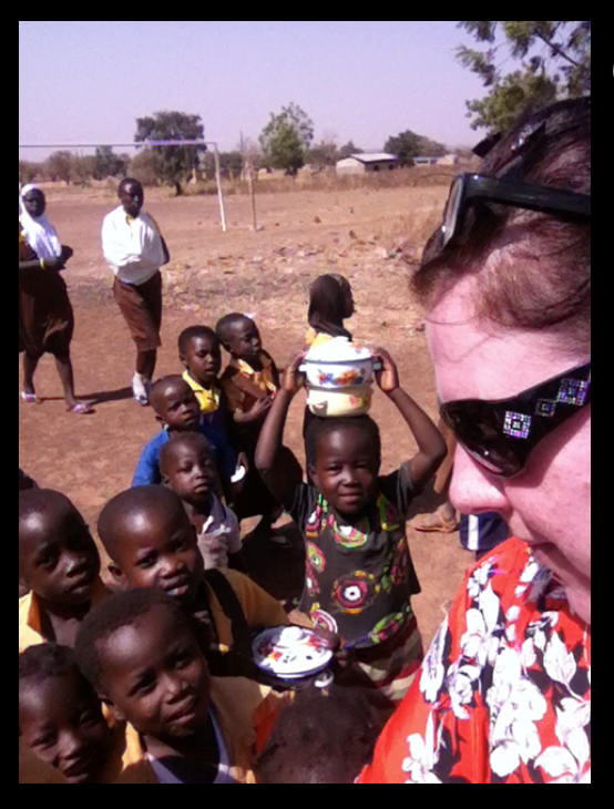 Children from Zoozugu run to me with their smiles